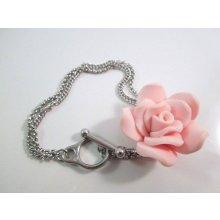 Aranys náramek z leštěné chirurgické oceli s kytičkou 9958 růžová